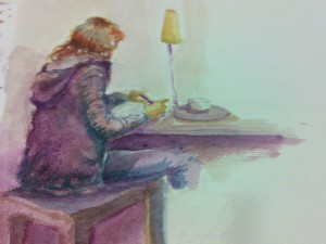A photo a sketch done by an unknown watercolorist, who was sketching Sunita while she was at the same cafe sketching strangers!