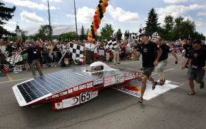 Caption 2 Steve (far right) cheering the University of Calgary solar car team over the finish line at the 2005 North American Solar Challenge (Photograph courtesy of Kyle Rebryna)